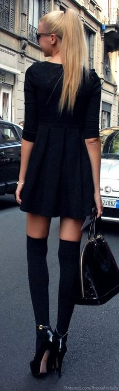 Try pairing long socks and identically colored heels with shorter dress
