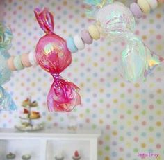 "Faux Candy Garland- you can make giant candy balls by using large styrofoam balls too. Scissors 1"" Styrofoam balls or 1"" wood beads Tweezers Heat gun Art Institute Glitter's Fantasy Film in a variety of colors"