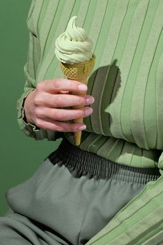 """The delightfully-named 'Wardrobe Snacks' series is a collaboration between photographer Kelsey McClellan and art director Michelle Maguire, who together form the collective 'Dusty'. Styled with retro clothing in satisfying palettes, the series features close-ups of hands elegantly holding a range of snacks, from an ice cream cone to an oyster, against carefully chosen clothing color schemes: coffee against cream, a donut against orange. """"Wardrobe Snacks was inspired by diners lacking the…"""