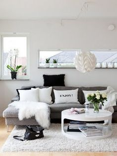 love the color scheme...gray couch, black and white pilows