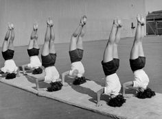 Girls from Hoover High School stand on their heads in gymnastics class, San Diego, Calif., 1946