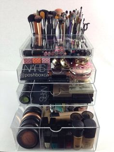 Vanity clear acrylic cosmetic organizer storage box with built in brush holder.