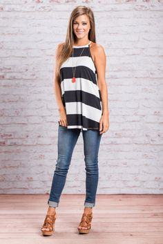 You will love this tunic tank with all your heart!! It's classically nautical navy and white stripes are so trendy! The large tied keyhole in the back is pretty adorable too! This tunic will look great paired with jeans and a necklace with a pop of color!