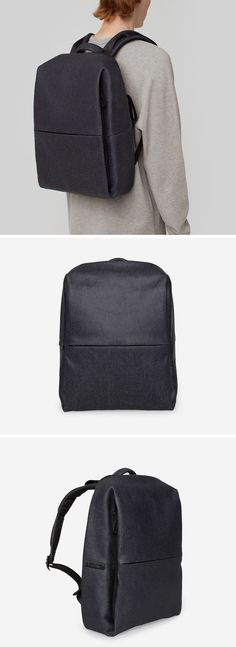 This minimalist blue denim backpack is designed to compress down to the thickness of a laptop when not in use, while also being able to expand to easily fit all your daily essentials.