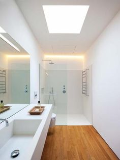 Badezimmer White, supple shower / lighting Mirrors and tiles should go all the way to the ceiling . Wood Bathroom, Bathroom Toilets, Bathroom Flooring, Bathroom Interior, Modern Bathroom, Small Bathroom, Bathroom Ideas, Bathroom Storage, Wainscoting Bathroom