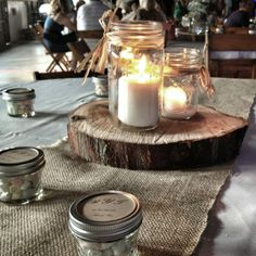 Mason Jar Centerpieces with wood cookie... I could match the dining room table with the mantel