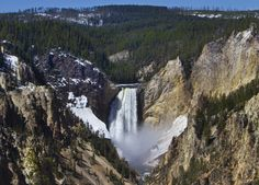 A massive waterfall roars over a cliff at Yellowstone National Park.  CREDIT: © Karine Aigner/NGC.