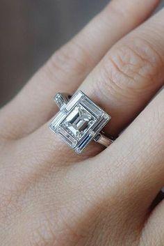 An emerald cut diamond engagement ring.