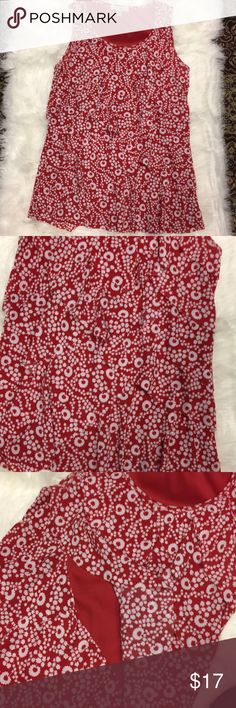 🆕❤️ Listing. Ruffled Tiered Top Red and white ruffled tiered top. Super cute. Fully lined in red. Sleeveless. Flower print. 100% Polyester. Last pic shows the red solid underlayer. Roz & Ali Tops