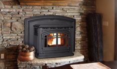 Enviro M55 Pellet Insert This insert is multi flue compatible with 55,000 btu's/hr which is enough to heat a 2,500 sq. ft. home with ease. If interested you may purchase a log set for aesthetics and you have the option to keep the glass doors open or closed while burning. With one of the highest efficiency ratings for a pellet insert, at 83.5% this stove will keep you nice and toasty! Call Heidi today for sale prices during February's Blow Out Sale. (603)-320-7318