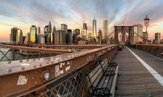"""Good morning from NYC What I Saw In NYC on Instagram: """"Photo by @david_nankervis Brooklyn Bridge  Some mornings you just have to stop for a minute and capture the sunrise. I had posted the view in the other direction four days ago. This was how Manhattan looked with the buildings reflecting those beautiful colors. #brooklynbridge #panorama #manhattan#skyline #nyc #newyork #newyorkcity#ig_great_shots_nyc #ig_nycity#seeyourcity #nycprimeshot#newyork_instagram #newyork_ig#instagramnyc…"""