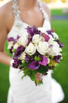 Purple Wedding Flowers Purple bouquet with a gold dress! More - Today I bring you some purple wedding bouquet inspiration! Hope you're inspired and find something that you like……. This beauty here has to be my favourite out of them all. Purple Wedding Bouquets, Wedding Colors, Flower Bouquets, Bridal Bouquets, Rose Bouquet, Bouquet Wedding, Lily Wedding, Blue Wedding, Wedding Dresses
