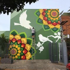 Incrível e novo trabalho de @danroots em Cachoeira do Sul. New work by @danroots in Brazil. Some colours on! #danroots #streetart #followthecolours #arte #mandala #mandalas #art