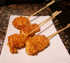 Crispy Corn Flake and Buttermilk Coated Fried Chicken Skewers  Brine:  4 cups water  1/4 c kosher salt  1/4 c sugar  1 clv garlic, smashed  3 sprg of thyme  3 stm of parsley  2 bay leaves  1 lemon,   1/2 t black peppercorns, cracked  2# boneless, skinless chicken breasts, cut into 1 ½ inch cubes  6 c canola oil for frying  Chicken Coating:  2 cups buttermilk  1 ½ teaspoons kosher salt  ½ teaspoon ground black pepper  6 cups all purpose flour  1/4 cup garlic pwdr  1/4 cup onion pwdr  1T paprika