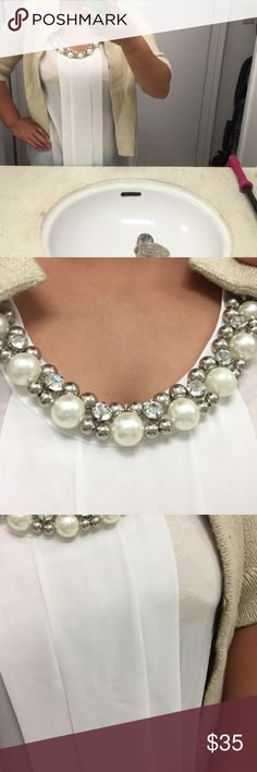 Beautiful sleeveless blouse Embellished top with beautiful accents of decorative pearls, silver beading, and diamond stud rhinestones. Brings out any outfit. Pleated down the middle. Excellent condition Tops Tees - Short Sleeve