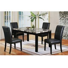 Get a high end look for less This cozy dining table features a faux