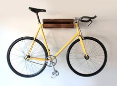 a possible DIY bike shelf? We have our bikes on the wall. Saves so much room!