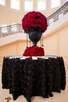 plastic urns from dollar store, black bead garland flower ball on top