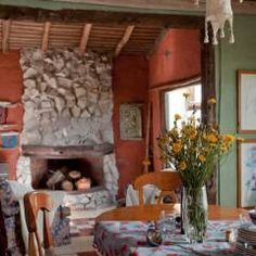 Salas de jantar rústicas por Susana Bellotti Arquitectos