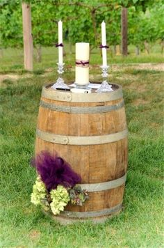 Using two wine barrels with a selection of different sized candles instead of an arch