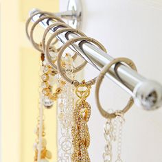Or keep jewelry accessible by using curtain or shower rings on an extra towel rod. | 15 Genius Dollar Store Bathroom Hacks Because Mess = Stress