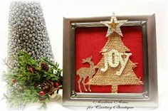 The Curtsey Boutique.  Framed Christmas Décor by Andrea Amu featuring burlap Christmas Tree, glittered reindeer, glittered star, book page star and fabric letters.