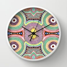 Primary Hypnosis Wall Clock by Liz Nehdi. FREE worldwide shipping through March 9 with this code: http://society6.com/LizNehdi?promo=efd5f6