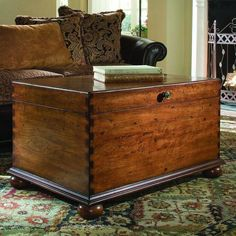 Features:  -Material: Hardwood solids with cherry veneers.  -Lift lid cocktail trunk.  -Top Finish: Cherry.  -Base Finish: Cherry.  -Top Material: Solid Wood.  -Base Material: Solid Wood.  Product Typ