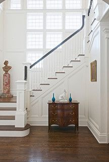 A medium brown with white painted trim would be a classic update.  Duraseal Antique Brown