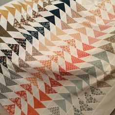 Ever since I spotted the Spring House Layer Cake Free Quilt Pattern by Moda Fabrics I have wanted to make this quilt. I loved that all I needed was a Layer Cake and some background yardage.  The desi