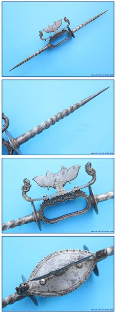 This rare and unusual palm weapon (vajra-mushti) is Indian, late 17 C., probably Central or South India. In a way it is a combination of a knuckle duster and a Bagh – Nakh Indian concealed weapon. It is held in the palm like a knuckle duster and has to long spikes of twisted steel extending to both sides. Beautiful work in steel. Length 19 inches.