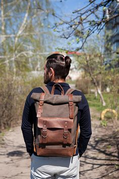 The backpack is made of high density cotton and genuine leather. Inside is a lining of durable cotton fabric, a soft pocket for a laptop with a lock on the button and a small zippered pocket for documents, etc. Excellent for the city and travel! Dimensions 30x50x12 cm and 25x40x10 cm