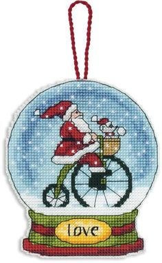 Dimensions Love Snowglobe (Christmas Ornament) - Cross Stitch Kit. This Christmas themed counted cross stitch kit features Santa Claus in a snow globe! This pac