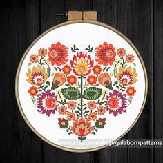 Title: Autumn floral heart ornament Based on traditional Polish embroideries This PDF counted cross stitch pattern available for instant download. Skill level: Beginner+. Pattern size (without white borders around): stitches: 112h x 130w ready design: 8.0h x 9.4w for 14-count