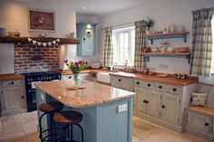 A beautiful bespoke farmhouse kitchen hand painted in Farrow & Ball Stony Ground with island and accents painted in Farrow & Ball Dix Blue. Kitchen Cabinet Colors, Blue Kitchen Cabinets, Style Tile, Modern Kitchen, Country Kitchen, Kitchen Colors, Vintage Kitchen, Kitchen Cupboards, Blue Kitchens