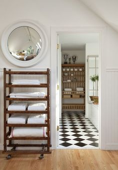 If you're short on space (no linen closet), a rolling rack steps up -- and looks great.