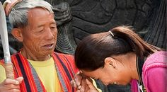 """Example of the Filipino custom greeting and farewell of """"Mano po,"""" which is a sign of respect towards elders and implies an asking of blessing."""