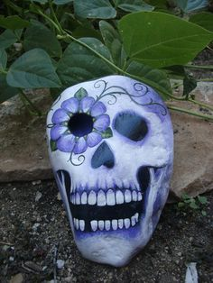 FEELING ALIVE painted skull rock with flowers by MyGardenRocks, $54.00