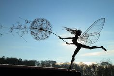 'Dancing with Dandelions' by Robin Wight outdoor moving fairy sculpture