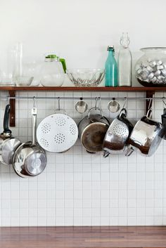 Kitchen shelves | © Bodil Johansson / Scandinav Bildbyrå #Interior #Home #Kitchen #Pots #Pans #Shelf #Shelving #Tiles