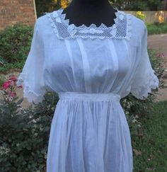This is a lovely Edwardian period Lace and Cotton Lawn Gown for a younger girl with banded Irish Crochet inserts with raised roses & leaves. Displayed parti