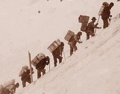 """Miners carry gear up Chilkoot pass to reach the Klondike. Read """"To Build a Fire"""" for London's vivid account of just how brutal extreme cold can be. Man fighting the elements to the end. To Build A Fire, Call Of The Wild, Most Popular Books, Short Stories, Kayaking, Alaska, Camel, London, Building"""
