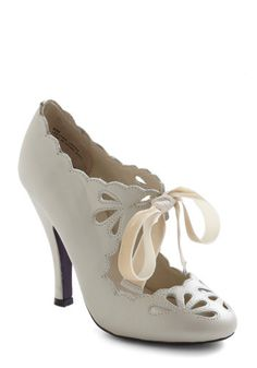 cream high heel shoes with ribbon