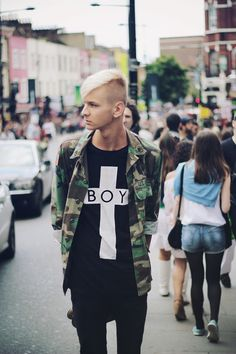 He's killing the game effortlessly. camo + Boy London .. and an amazing haircut