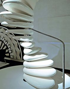 """""""This spiral staircase appears to lead to nowhere as it was installed as a part of Milan's exposition aimed to show that decor objects can be artworks.The 'Rolling', designed by Roberto Semprini for Edilco, draws inspiration from the ergonomic forms of natural rocks smoothed by water. The stairs look like giant river stones, but they are actually concrete blocks polished to perfection."""""""