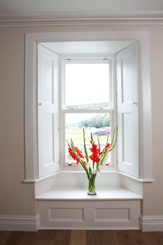 Lovely window seat beneath deep bevelled reveal sash windows