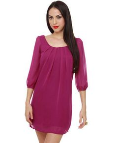 Says it's a dress, but I'd say it's more of a tunic length. Still, I love the color, and the style. It'd be great with some skinny jeans and heels.