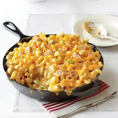 King Ranch Chicken Mac and Cheese | All the flavors of a favorite casserole come together in the comfort of mac and cheese. Serve this dish to your family, and it will become a quick favorite. | SouthernLiving.com