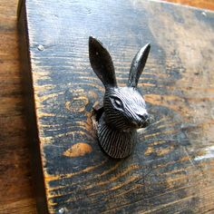 Considering doing up a plain chest of drawers. These knobs would be so cool!  Hare Drawer Knob - notonthehighstreet.com