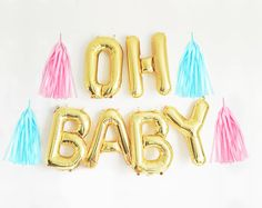 A fun modern way to celebrate the new little guy or girl on their way! This garland is perfect decoration for baby showers and gender reveal parties. Kit includes: 14 gold balloons that spell OH BABY (6 balloons total) 3 yards of twine Straw for easy balloon inflation. Optional tassels (see below) - - - - - - - - - - - - - - - - - - - - - - - - - TASSEL OPTIONS: Pink Tassels: Youll receive 2 pink tassels (1st picture) Blue Tassels: Youll receive 2 light blue tassels (2nd picture) Pink &a...